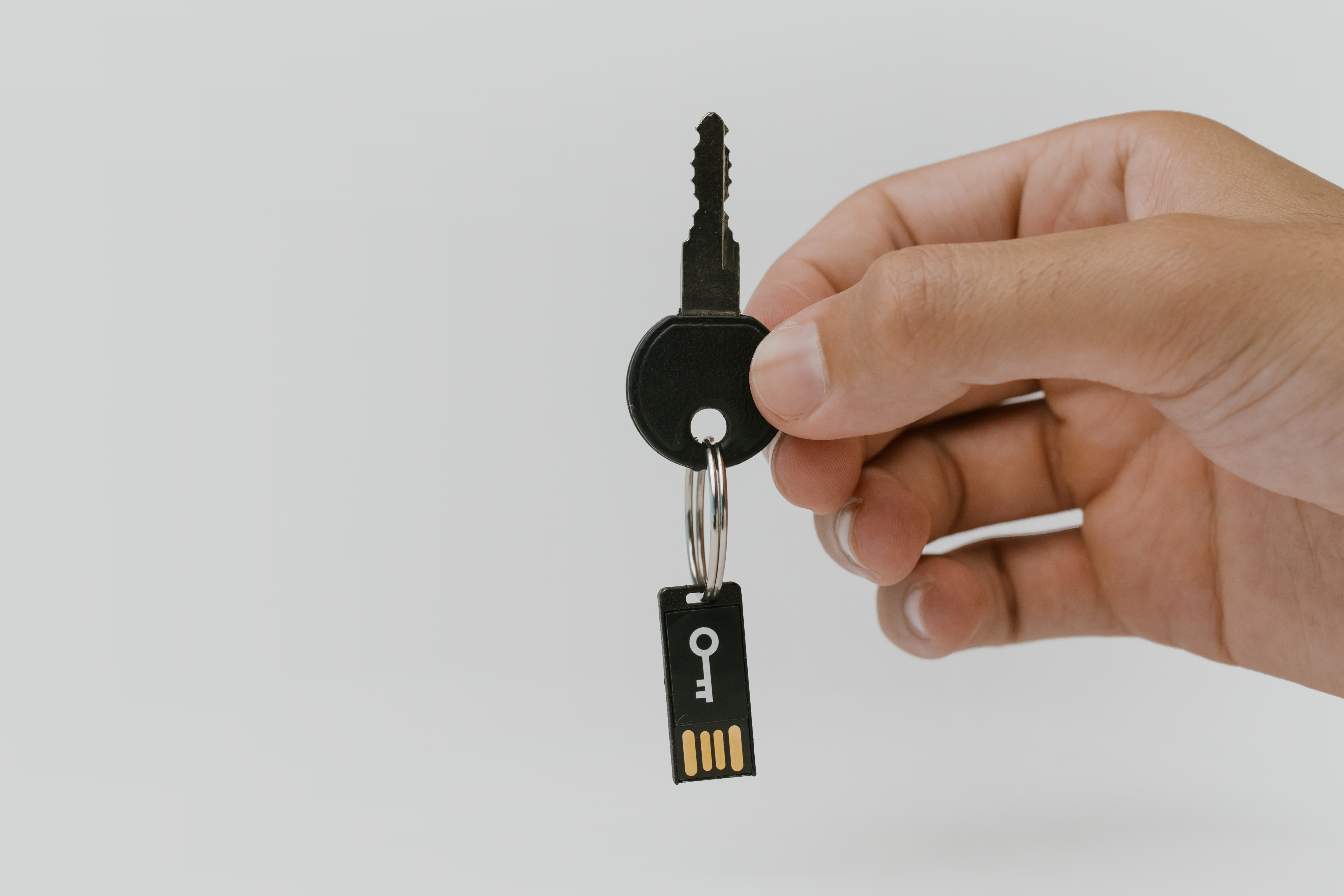 Hand holding key and protected USB.